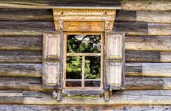 Window of old house with carved wooden trim Royalty Free Stock Images