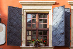 Window in old house decorated with geranium flowers. Window in old house decorated with geranium flowers royalty free stock images