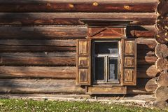 Window of an old house from logs stock photography