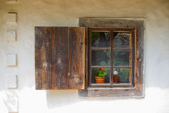 Window of the old house. A window open shutters of the old house Stock Photography
