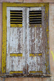 The window of old house with shutting shutters Royalty Free Stock Photo