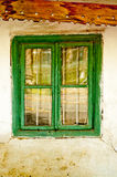 Old house window. Window of old house. wooden window frame green painted. dirty destroyed house detail Royalty Free Stock Photo