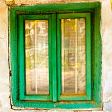 Old house window. Window of old house. wooden window frame green painted. dirty destroyed house detail Stock Images
