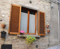 Window in an old natural stone house Royalty Free Stock Photo