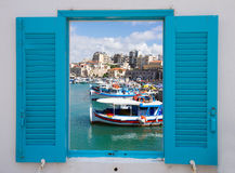 Window with old port of Heraklion, Crete, Greece Royalty Free Stock Photography