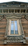 Window of an old russian house decorated with carving, Russia Royalty Free Stock Photography