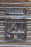 Window with old shutters from the boards. Old log house. Background Stock Image