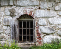Window in old stone and brick wall Stock Image