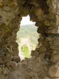Window in an old stone fortress Royalty Free Stock Photo