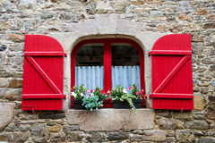 Window in old stone house France Stock Photo