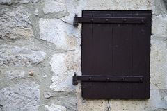 Window in the old stone wall Royalty Free Stock Photography