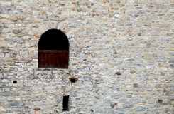 Window in old stone  wall of medieval castle Royalty Free Stock Image