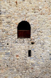 Window in old stone  wall of medieval castle Stock Photos