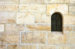 Window in old stone wall Royalty Free Stock Photo