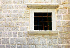 Window in old stone wall Stock Photo
