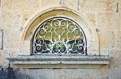 Window in old stone wall Royalty Free Stock Image