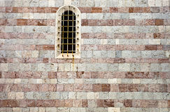 Window in old stone wall Stock Photography