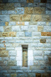 Window in an old stone wall of a round tower. Europe, the Middle Royalty Free Stock Images