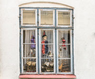 Window with old string puppets and model ships Stock Photography