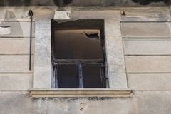 Window of old tenement house. A window of an old tenement house without glass panes stock photography