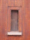 Window in old timber door in Leiden Royalty Free Stock Photo