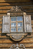 Window in old timbered wall. With shutters and white lacy curtains, old russian village, Karelia, Russia Royalty Free Stock Images