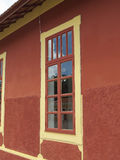 Window of an old train station. Of the last century, disused, with reflection in the panes, with earthy and yellow walls in , in the interior of Brazil Stock Images