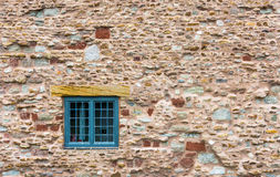 Window on old wall. The wall has a mix of textures. By the window, you realize you how construction was built Royalty Free Stock Images