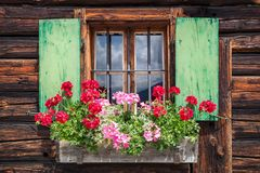 Window of an old wooden cabin in the alps Royalty Free Stock Image