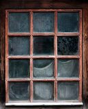 The window of an old,wooden farm house with net Royalty Free Stock Photo