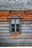 Window in old wooden house. Window of an old, wooden Slav house. Nowogrod Heritage Park, Masuria, Poland Royalty Free Stock Image