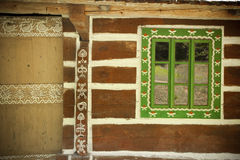 Window of an old wooden house. Ethnographic values on a countryside Royalty Free Stock Photography