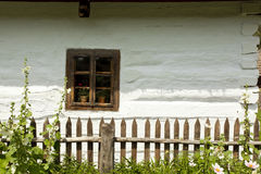 Window of an old wooden house. Ethnographic values on a countryside Stock Photos