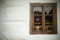 Window of an old wooden house. Ethnographic values on a countryside Royalty Free Stock Photo