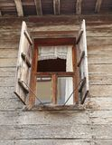 Window of a old wooden house with shutters Stock Photography