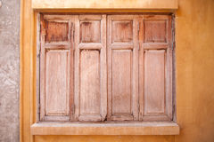 Window of old wooden house wall Stock Photo