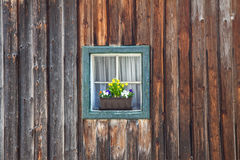 Window of old wooden log house on wall background Stock Images