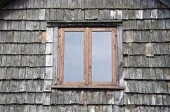 Window on old wooden village house wall Stock Photos