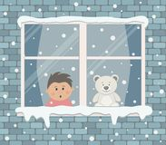 Free Window On A Brick Wall On A Snowy Day. A Little Boy In The Room Is Surprised, Looking At The Snow Stock Photo - 154118760