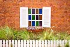 Window. Open Old Window With Flower Basket On Brick Wall Stock Photo