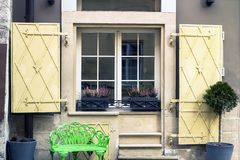 Window with open shutters and heather flower in pots stock photography