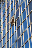 Window opened on glass facade of modern building Royalty Free Stock Photos