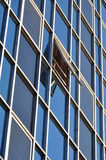 Window opened on glass facade of modern building Royalty Free Stock Photography
