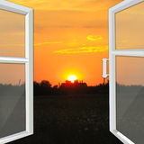 Window opened to the bright sunset Stock Images