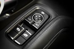 Window opener. Detail on buttons controlling the windows in a car Stock Photos