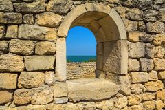 Window and wall of natural stone os background. Royalty Free Stock Photo