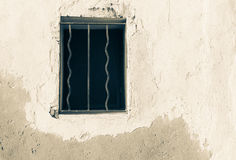 Window opening with bars in wall Stock Photo