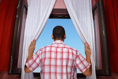 Window of opportunity. Man looking into distance through an open window Stock Image