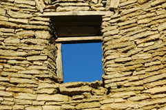 Window of opportunity. Window opening in an old limestone wall Royalty Free Stock Image