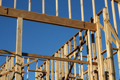 Window of Opportunity under Construction. A home under construction with the focus on the window frame, against a blue sky royalty free stock image